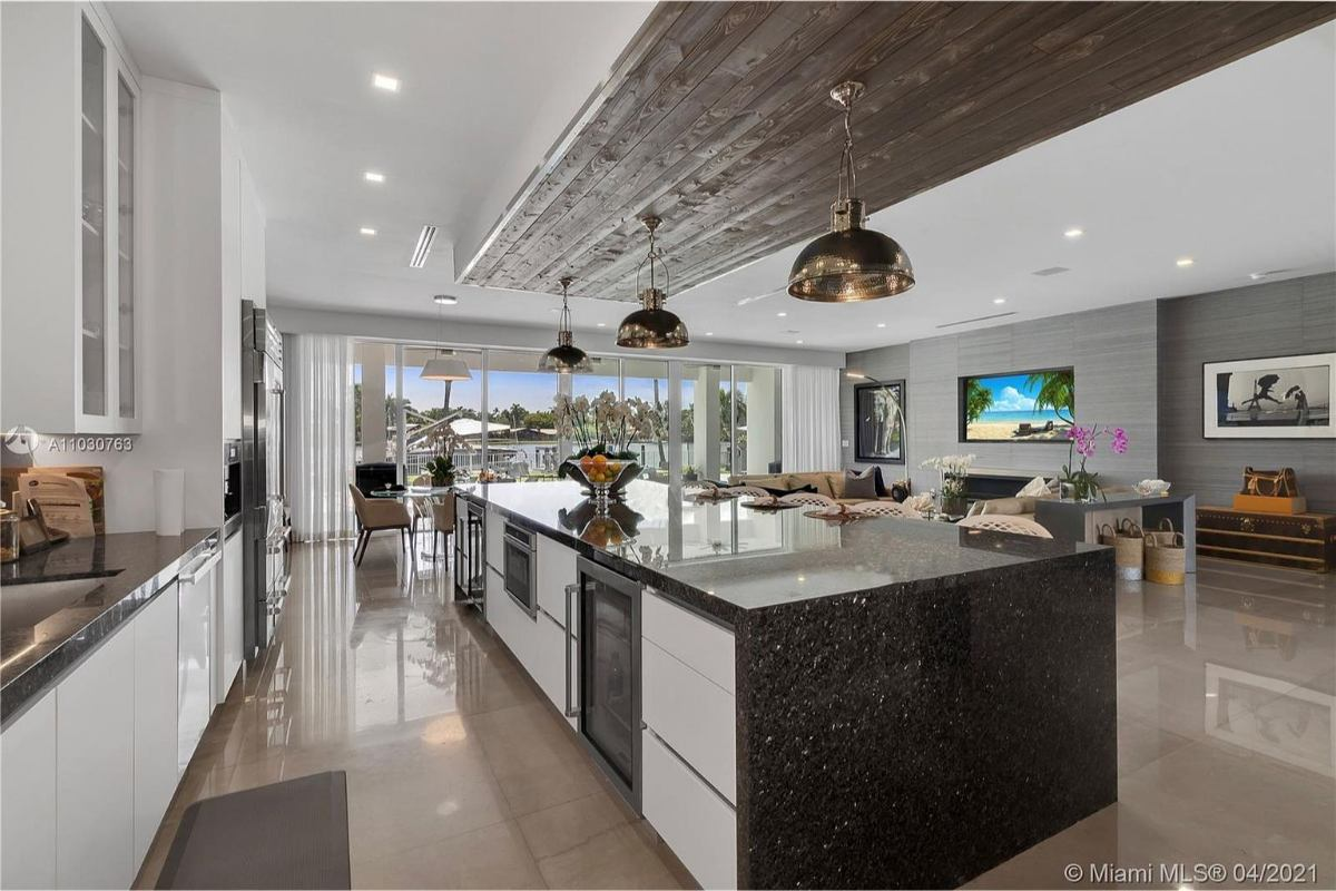 Today's featured Home Of The Day is a stunning 5-bedroom, 6-bathroom waterfront jewel in Hollywood Florida.