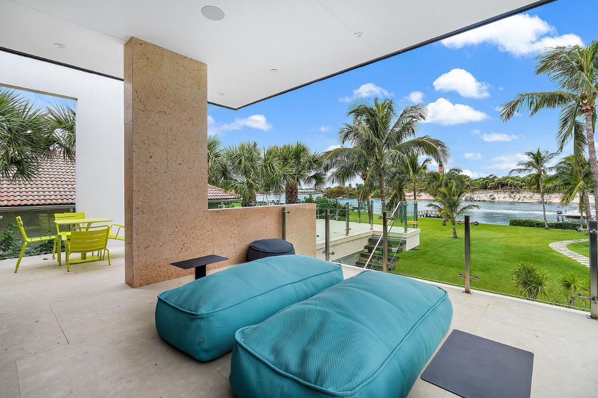 Today's Featured Home Of The Day is a stunning 6-bedroom, 8.5-bath modern waterfront dream home in the prestigious Jupiter Inlet Colony.