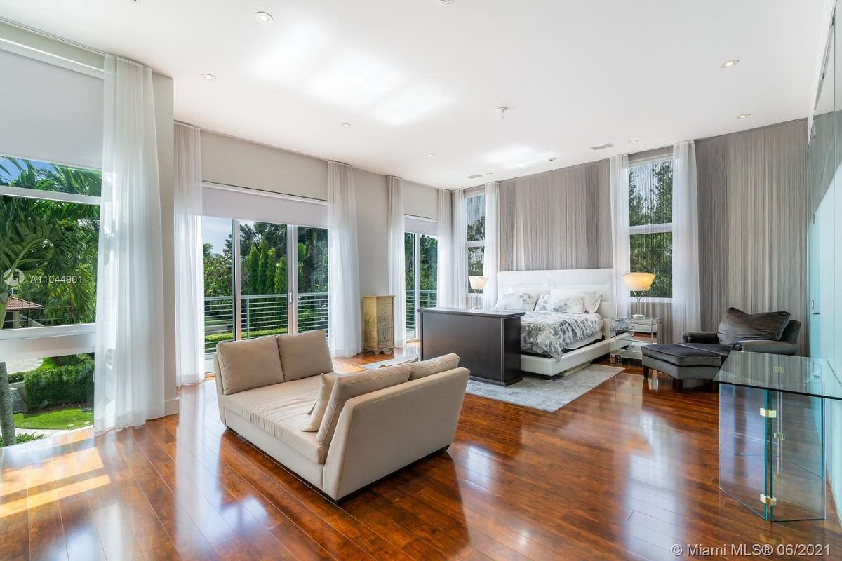 Today's featured Home Of The Day is a stunning contemporary island residence on Miami Beach's coveted San Marino Island.