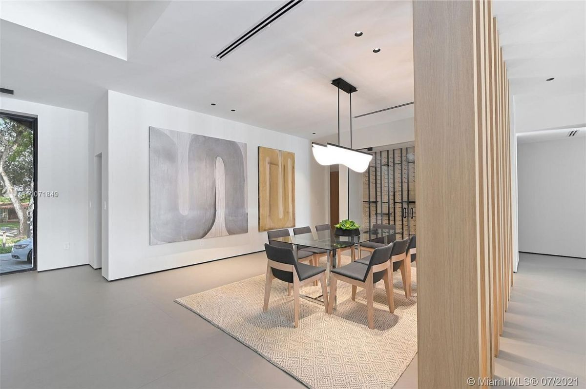 Today's featured Home Of The Day is an impeccably redesigned residence in the exclusive Loch Lomond community of Miami Lakes, Florida.
