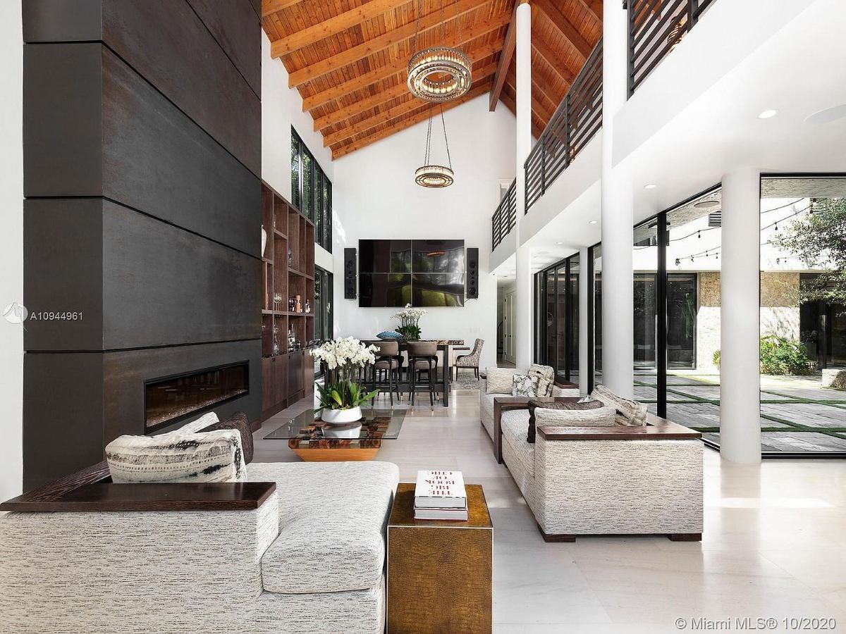 Today's featured Home Of The Day is a beautifully rebuilt 7-bedroom, 6-bath custom estate in Coral Gables.