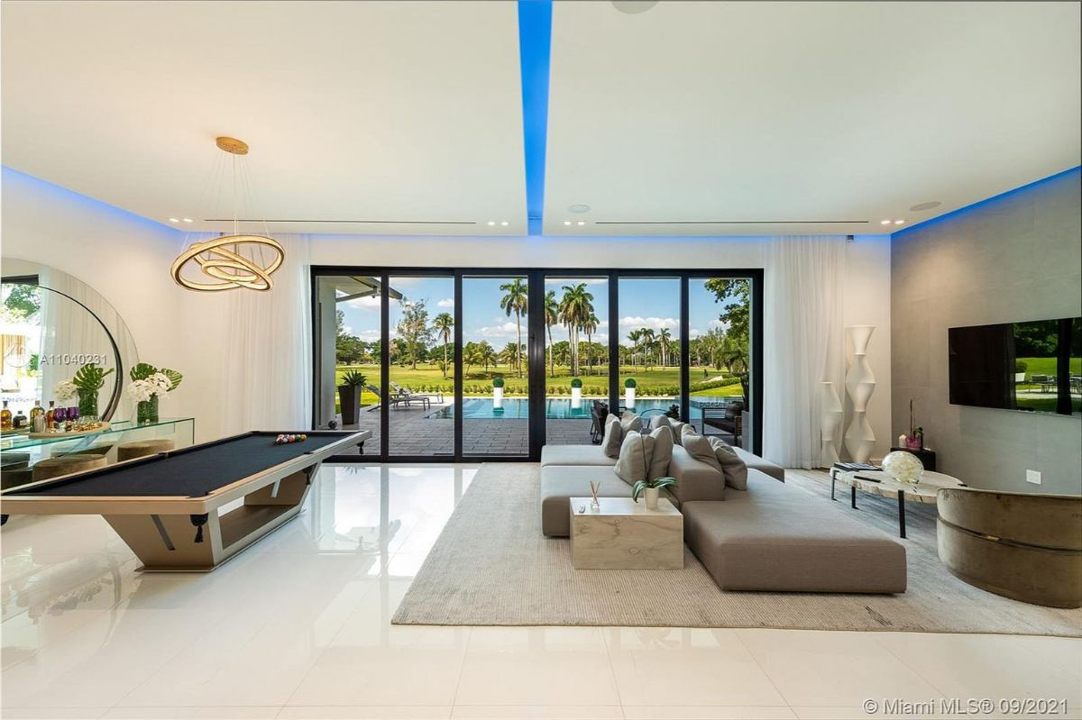 Today's featured Home Of The Day is a spectacular 6-bedroom golf course home in Miami's highly sought-after Loch Lomond community.