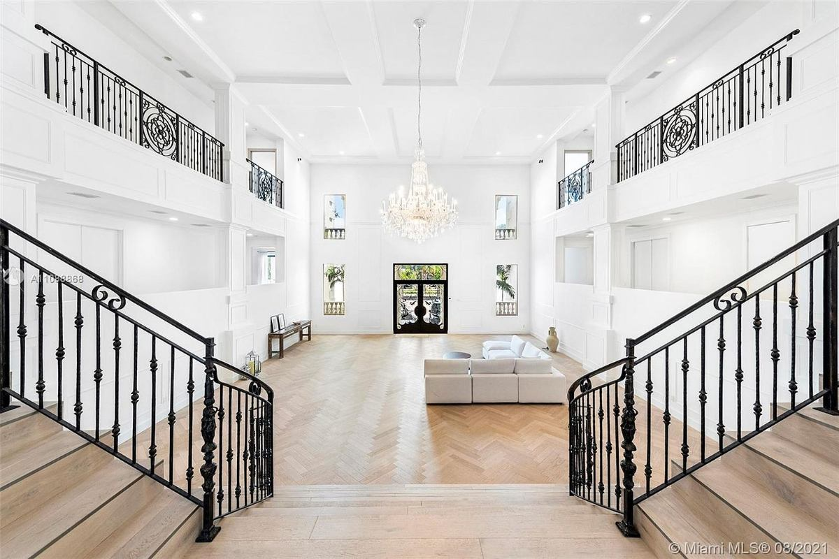 Today's featured Home Of The Day is a palatial waterfront residence on Miami Beach's prestigious Palm Island.